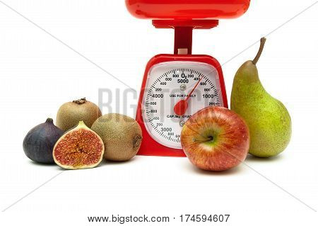 kitchen scales and fresh fruit on a white background. horizontal photo.