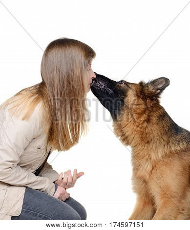 Young woman and her german shepherd dog isolated on white. Dog Kisses its master.