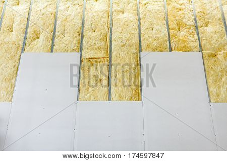 View at unfinished thermal partition dry wall with mineral wool. poster