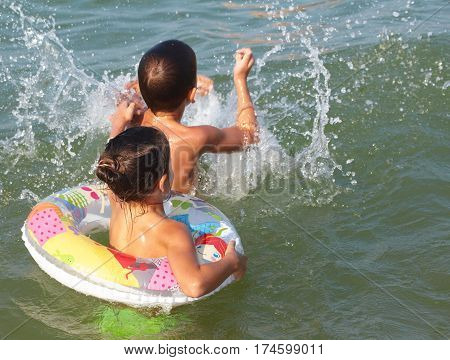 Children Played In The Sea With Rubber Ring