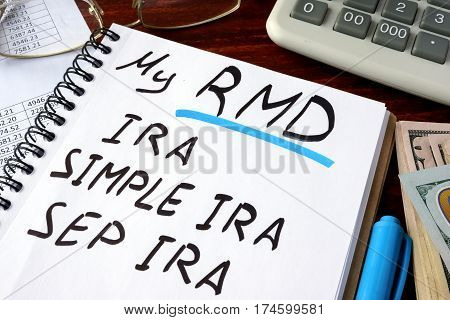 My RMD (Required Minimum Distributions) IRA, SIMPLE IRA, SEP IRA written in a notebook.