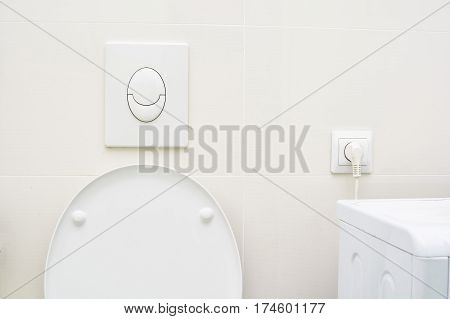 Toilet pan with push wall button for flushing