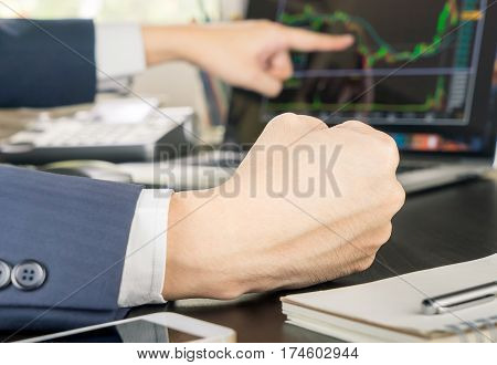 Stock trader is confidence about his stock on screen