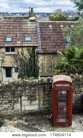 British postbox.Red mailbox in town in Wiltshire county.