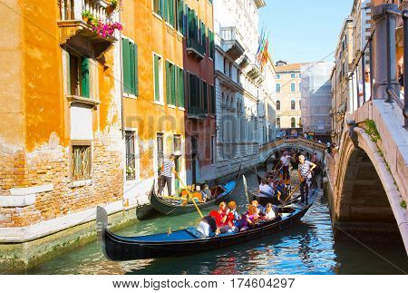 VENICE ITALY - JULY 2016. Traffic jam in Venice. Crowded traffic of gondolas in one canal. Europe.