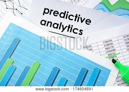 Predictive analytics written in a document business charts.