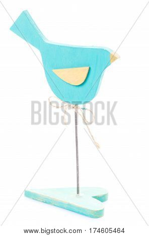 Handmade wooden bird on Stand in the form of heart isolated on white. Love concept. the day of Saint Valentine gift