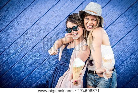 Friends eating ice cream outdoor on blue background