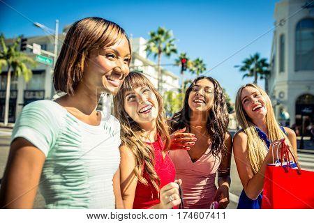 Women making shopping in Beverly hills shops