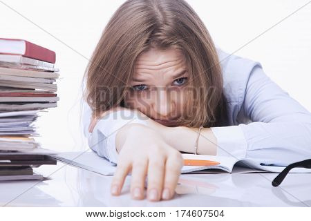 tired and exhausted woman working with documents (psychological portrait aggression anger frustration)