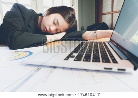 business woman tired asleep on the office room while working. poster