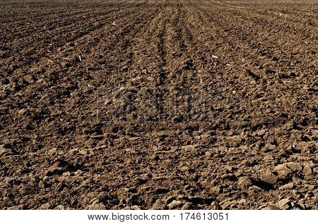 Ploughed Soil In Agricultural Field Arable Land