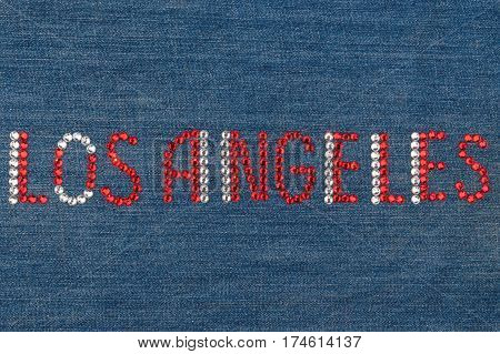 Inscription Los Angeles inlaid rhinestones on denim. View from above