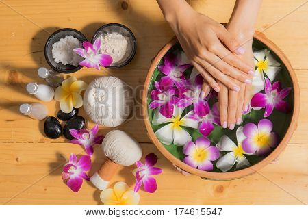 Woman Hands With A Bowl Of Aroma Spa Water Oil