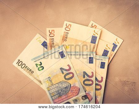 Euro Money Banknotes On Textured Backdrop. Top View Toned