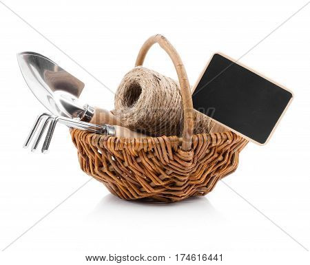 Garden tools with seedlings vegetable on a white background
