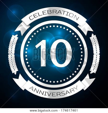 Ten years anniversary celebration with silver ring and ribbon on blue background. Vector illustration