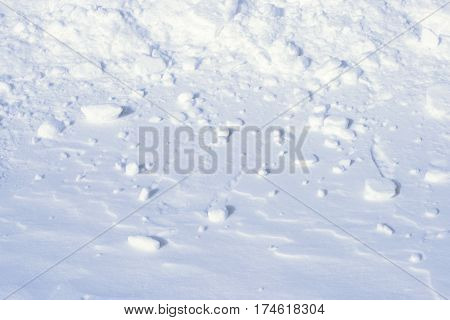 White snowy field with clumps of snow