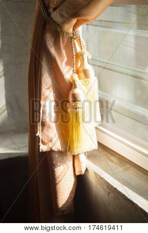 Curtain tassel beautiful curtain on window at home