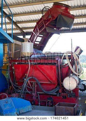 agricultural sugarcane harvesting machine and attached mechanisms