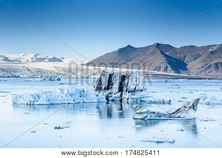 Beautiful view of icebergs in glacier lagoon Iceland selective focus global warming and climate change concept