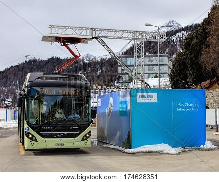St. Moritz, Switzerland - 3 March, 2017: a Volvo 7900 Electric Hybrid bus at the quick-charge facility on Bahnhofplatz square. Buses of this type use electrical power coming from accumulators for normal operation mode.
