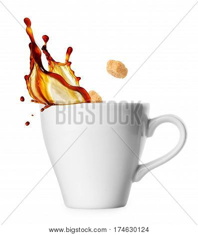 small classical white cup of coffee espresso with splash and falling sugar cubes isolated on white background. Coffee splash from a cup. Cane sugar cubes being dropped into coffee creating splash