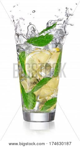 lemonade in a glass with splashing isolated on white background. Detox drink water with lemon, mint and cubes of ice. Cocktail splash from a glass. Splashing drink