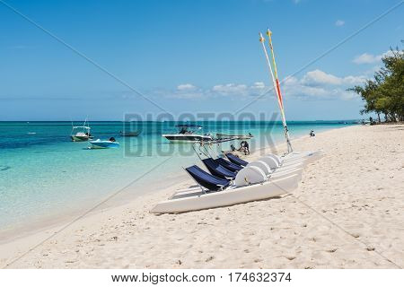 Le Morne Mauritius - December 11 2015: Leisure time possibilities pedal boats catamarans on the Le Morne Beach one of the finest beaches in Mauritius and the site of many tourism facilities.