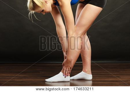 Woman Athlete With Ankle Injury