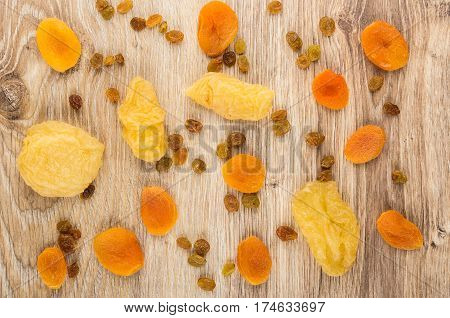 Scattered On Table Dried Pear, Dried Apricots And Raisins