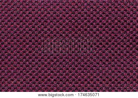 Dark purple background with checkered pattern closeup. Structure of the fabric macro.