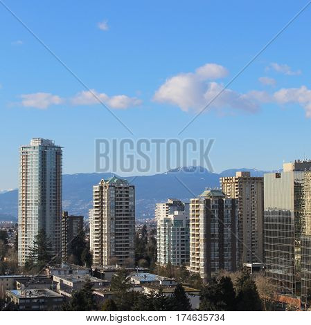 City Landscape With High Rises And Mountains