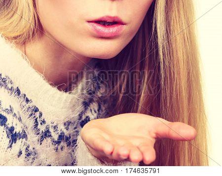 Blonde Womn Sending Air Kiss On Palm Hand