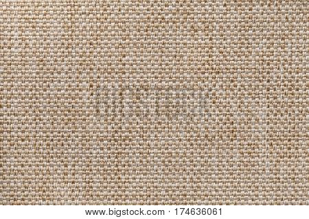 Light brown textile background closeup. Structure of the fabric macro.