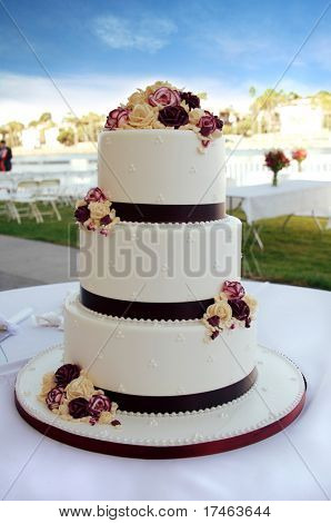 Beautiful White and Burgundy Wedding Cake With Flowers