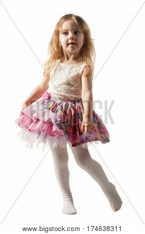Cute three-year girl is jumping, running, dancing, laughing. Her hair is not combed.I solated on white background