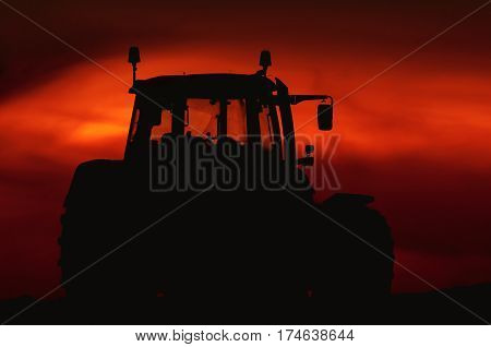 TRACTOR - Modern agricultural machine on the field