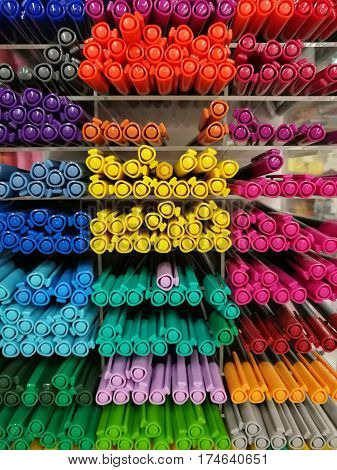 Colorful pen on shelves in stationery store or department store Colorful highlight pen on shelf focused on yellow highlight pen