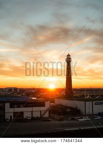 IJMUIDEN - NETHERLANDS - 20 JAN. 2017: View on the sea port IJmuiden, Netherlands, as the sun sets. IJmuiden port is located at the entrance to the North Sea Canal area