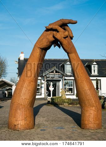 GRETNA GREEN, SCOTLAND - 21 JAN. 2017: Sculpture by Ray Lonsdale of clasping hands at Gretna Green, the town on the Scottish border where eloped couples get married