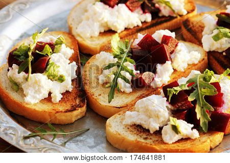 Appetizer - bruschetta with beet, feta and ruccola