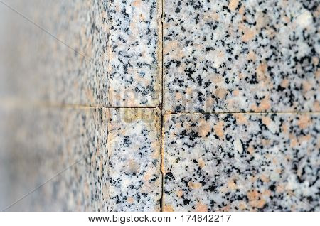 Polished granite wall. Outside corner junction granite slabs