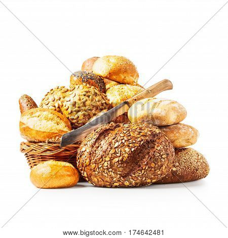Fresh bread basket of rolls and buns and cutting knife isolated on white background clipping path included