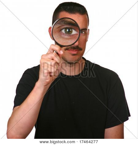 Man Holding Magnifying Glass Looking Close into the Matter: Large Eye in Focus
