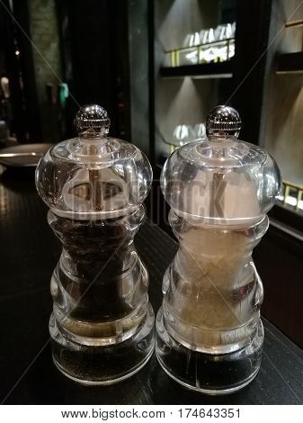 salt and pepper on the table in the restaurant with blur background salt and black pepper for seasoning main dish back pepper for meal