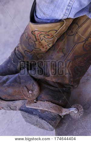 detail of cowboy dirty boots with spurs