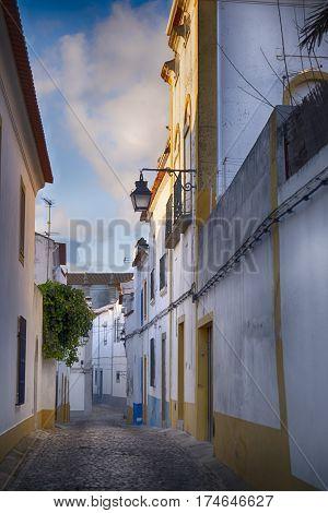 narrow street in the historic city of Evora Portugal