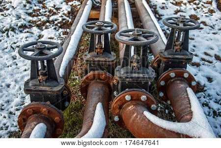 steel pipes and valves on industrial enterprise