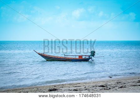 single typical colorful thai longtail boat in ocean water